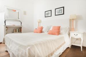 Ein Bett oder Betten in einem Zimmer der Unterkunft Casa Di Capri