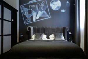 A bed or beds in a room at Malmaison Glasgow