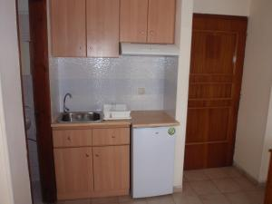 A kitchen or kitchenette at Vazakas Rooms