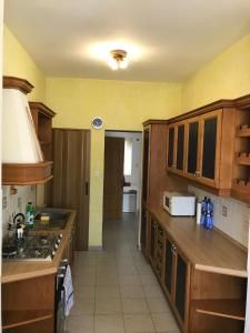 A kitchen or kitchenette at Swieqi Semi Detached Maisonette