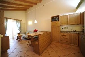 Cucina o angolo cottura di Residence Lagorai - Fiemme Holidays