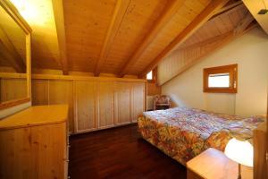 Letto o letti in una camera di Residence Lagorai - Fiemme Holidays