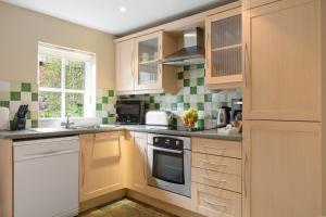 A kitchen or kitchenette at Thurnham Hall By Diamond Resorts