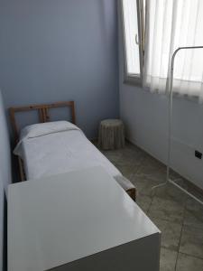 Letto o letti in una camera di Dalia