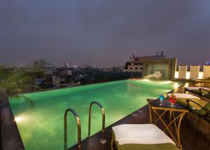 The swimming pool at or near The Lapis Hotel
