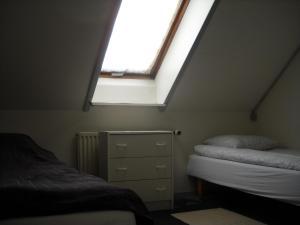 Ein Bett oder Betten in einem Zimmer der Unterkunft Hotel Gedser Apartments