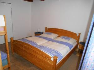 A bed or beds in a room at Chalupa Anton