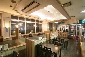 A restaurant or other place to eat at Tendo Central Hotel