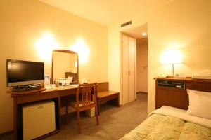 A television and/or entertainment center at Tendo Central Hotel