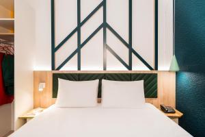 Un ou plusieurs lits dans un hébergement de l'établissement ibis Styles Rouen Val De Reuil