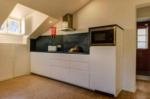 A cozinha ou kitchenette de Ribeira Cinema Apartments