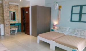 Ένα ή περισσότερα κρεβάτια σε δωμάτιο στο Ίδη