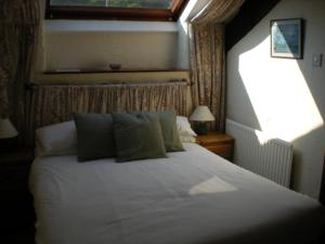 A bed or beds in a room at The Black Bull Inn and Hotel