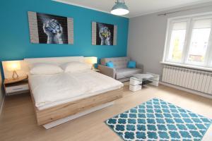 Łóżko lub łóżka w pokoju w obiekcie Apartamenty Świnoujście - Słowackiego