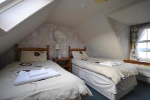 A bed or beds in a room at Saucy Mary's Hostel