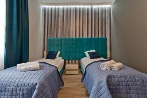 Łóżko lub łóżka w pokoju w obiekcie Apartamenty Gdańsk EU - Apartamenty Gdańsk Stare Miasto