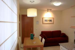 Een zitgedeelte bij Aparthotel Milord's Suites