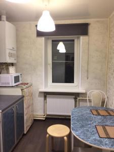 Кухня или мини-кухня в Апартаменты Всполье 4