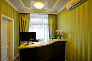 A television and/or entertainment center at Boutique hotel Megapolis