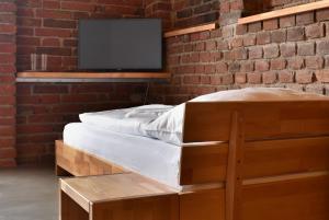 Postel nebo postele na pokoji v ubytování Pivovar Lindr Mžany