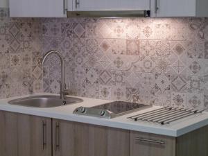 A kitchen or kitchenette at Fiscardo Studios