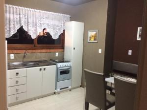 A kitchen or kitchenette at Residencial Quatro Estações