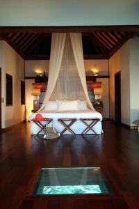 Cama o camas de una habitación en Sofitel Kia Ora Moorea Beach Resort