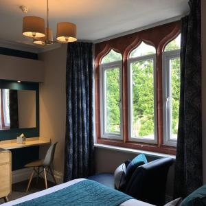 A seating area at The Hideaway At Windermere (Adults only)