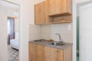 A kitchen or kitchenette at Aerides Boutique Rooms