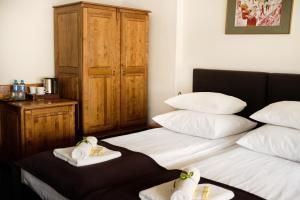 Łóżko lub łóżka w pokoju w obiekcie Hotel Eden