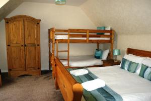 A bunk bed or bunk beds in a room at Royal Lodge