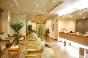 The lobby or reception area at Hotel Route-Inn Jouetsu