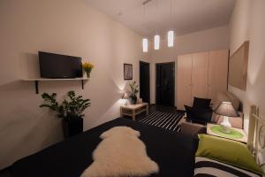 Кровать или кровати в номере Apartment Chernomorskaya 10 Lux