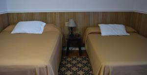 A bed or beds in a room at Gorgeous View Motel