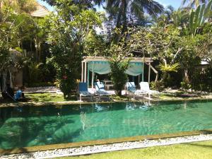 A garden outside Aquaria Eco Resort