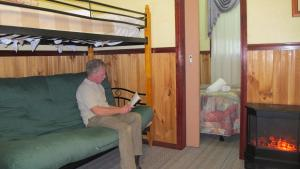 A bunk bed or bunk beds in a room at Cedar Lodge Cabins