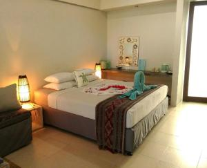 A bed or beds in a room at Aquaria Eco Resort