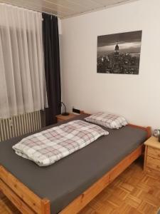 Ein Bett oder Betten in einem Zimmer der Unterkunft Apartment near Stuttgart Messe / Trade Centre
