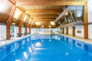 The swimming pool at or near Woodford Bridge Country Club By Diamond Resorts