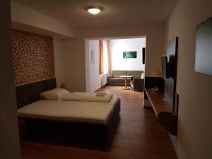 Ein Bett oder Betten in einem Zimmer der Unterkunft Sporthotel Zátoň