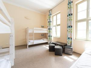 A bunk bed or bunk beds in a room at Wombats Hostel Budapest
