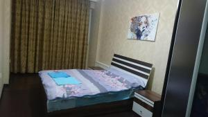 Cama ou camas em um quarto em Apartment on Xudu Məmmədov 36