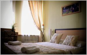A bed or beds in a room at Kitay-Gorod hotel