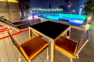 The swimming pool at or near The Raintree Dhaka