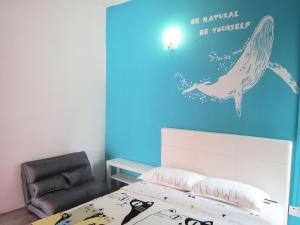 سرير أو أسرّة في غرفة في MILU Homestay - Kuala Selangor