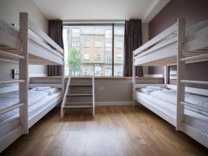 A bunk bed or bunk beds in a room at Wombats Hostel London