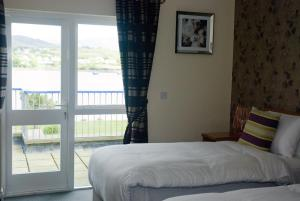 A bed or beds in a room at The Beara Coast Hotel