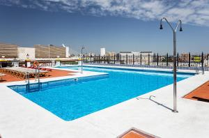The swimming pool at or close to Exe Sevilla Macarena
