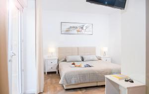 A bed or beds in a room at Ragusina luxury apartments