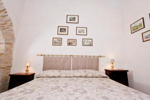 Letto o letti in una camera di Palazzo Forani
